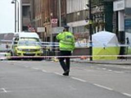 breaking news: murder squad police hunt killer after man is stabbed to death on a london street