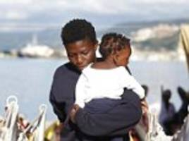 over 1,000 migrants including a four-day-old baby and 20 pregnant women are rescued by italian red cross off the coast of libya