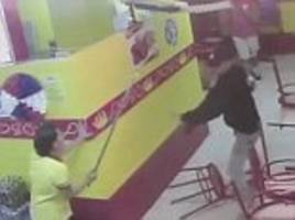 Plucky fried chicken restaurant waitress fights off two armed robbers with a broom handle when they attempt to steal from her till