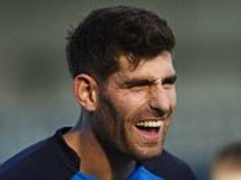 Ched Evans endures unhappy return to the pitch as Chesterfield striker is subjected to distasteful chants