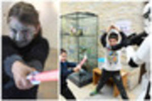 sci-con at the collection trains young jedi in light sabre...