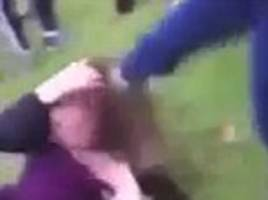 sickening moment a young girl is kicked in the head by a female attacker who drags her by the hair and punches while children watch and film it