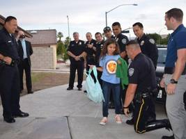 Palm Springs Police Surprise Slain Officer's Daughter, Escort Her to School