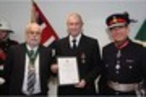 Burton firefighter gets award for 20 years of loyal service and...