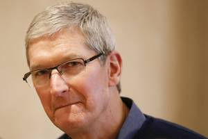 Apple CEO Tim Cook got testy after an analyst asked him if Apple has a 'grand strategy' (AAPL)