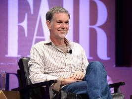 Netflix's CEO has a warning for AT&T and Time Warner — but generally favors the merger (NFLX)