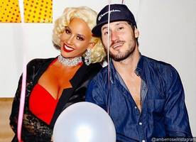amber rose cozying up to 'dwts' pro val chmerkovskiy at her birthday party