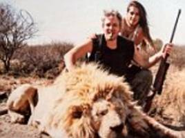 argentinian millionaire businessman sparks outrage after pictures are leaked of him and model wife posing next to dead lions, tigers and hippos in trophy images