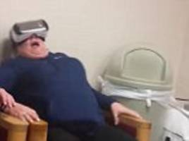 Chicago mom freaks OUT during a VR 'rollercoaster' that has family crying with laughter