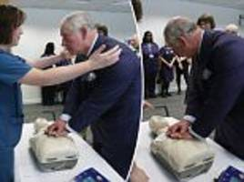 prince charles performs cpr on a dummy hospital visit