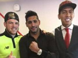 amir khan meets up with liverpool stars including philippe coutinho, roberto firmino and alberto moreno after efl cup win over tottenham