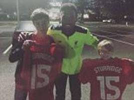 liverpool striker daniel sturridge hands out match-worn shirts to fans in car park after scoring twice in efl cup win over tottenham at anfield