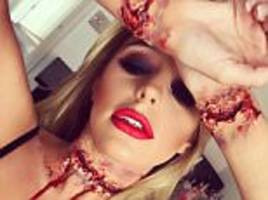 towie's amber dowding apologises to fans after halloween 'slit wrists' costume
