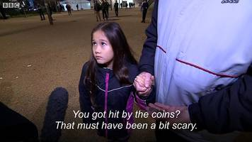eight-year-old hit with coins at match