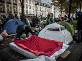 paris's new tent city: french capital is scarred by growing campsites as thousands of migrants turfed out of the jungle pitch up before launching new attempts to reach britain