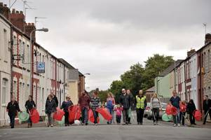 around 20 refugees will join forces with local residents to help clean up a community