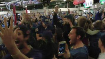 chicago cubs fans go wild after world series win