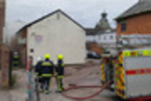 video: shops evacuated as fire breaks out through tiverton's...