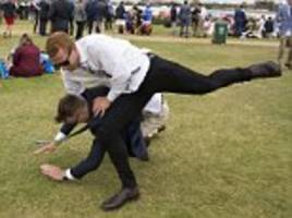 isn't it meant to be family day? shocked onlookers watch punters viciously fight each other as the melbourne cup carnival draws to a rowdy end