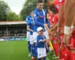 rochdale name five-year-old boy to matchday squad in touching gesture