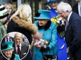 they're not fair weather royals! the queen and the duke of edinburgh brave the rain to open a medical research centre in london