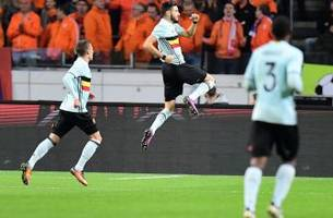 yannick carrasco helps belgium draw netherlands in friendly
