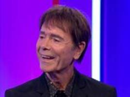 awkward! cliff richard makes his first appearance on the bbc even though he's suing it - and insists relationship with the corporation is 'just fine'
