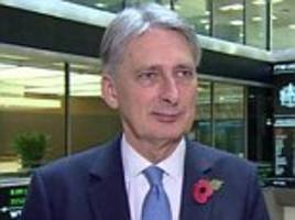 we need open markets and free trade for prosperity, philip hammond warns donald trump amid fears the new president will launch trade wars to protect america