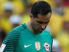 claudio bravo gives manchester city injury scare as goalkeeper hobbles off with a knee problem for chile