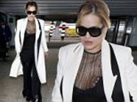 rita ora flaunts her ample assets in very low cut bustier at heathrow airport