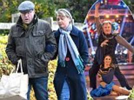 strictly come dancing's ed balls looks pale as he walks to the shops with his mp wife