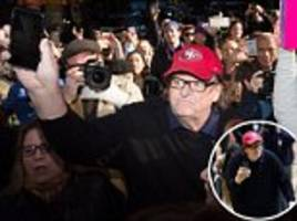 michael moore calls on donald trump to step down before joining protesters in new york