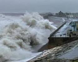 one dead, one missing as storm batters britain