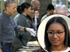 sasha obama helps parents serve thanksgiving meals to veterans in dc
