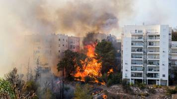 israel fires: tens of thousands flee as fires hit haifa
