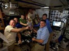 Astronauts enjoy a zero-gravity Thanksgiving dinner on the International Space Station