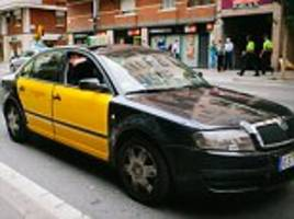 tourist who left a suitcase containing 10,000 euros in the back of a barcelona taxi is reunited with the cash after the honest cabbie handed it in to police