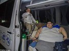 World's fattest man, 32, is discovered to be nearly 15 stone heavier than first thought and weighs a near record-breaking 92 stone 9lbs