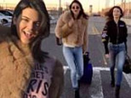 bella hadid and kendall jenner fly the flag for victoria's secret as they join bevy of lingerie models for private jet flight to paris