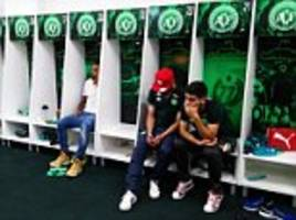 heartbreak in the locker room: anguished chapecoense players who were not on board the doomed flight with their brazilian team-mates react with shock as they learn of colombian plane tragedy