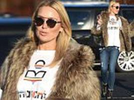 Pregnant Alex Gerrard covers her baby bump in loose t-shirt and coat in Liverpool