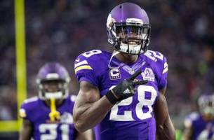 Adrian Peterson sprinting on the sidelines at Minnesota Vikings practice