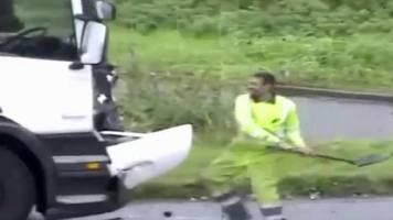 Driver attacks lorry cab with shovel