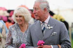 live: prince charles and camilla visit cambridge