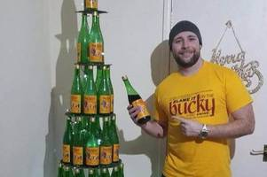 Tis the season to be jolly: Clydebank couple make Christmas tree out of 98 bottles of Buckfast