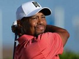 Tiger Woods looks sharp on return to golf after 15 months out with TWO eagles in first nine holes
