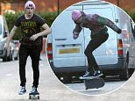 Brooklyn Beckham performs skateboard stunts in the middle of the street in Primrose Hill