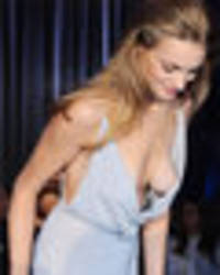 joanna krupa provides sideboob spectacle – but is upstaged by near-topless model