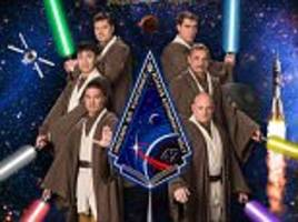 from space to hollywood: nasa astronauts transform into jedi knights and wizards to recreate iconic sci-fi film posters