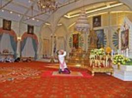 the king and i: thailand's crown prince ascends to take the crown 50 days after his father's death as flunkies lie on the floor around him like a scene from the famous musical